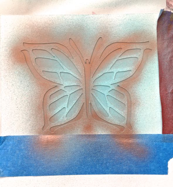step 6 - Working with the airbrush very close to the design and a fine spray, paint the body of the butterfly and the outer edges with copper paint.