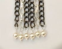 step 10 - Before closing the loops, attach the beads to the ends of the chains. Remove or add links to the individual chain strands to make them all the same length or alternate the lengths if desired.
