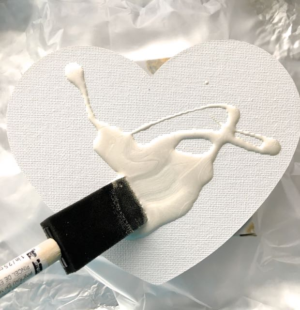 step 6 -Generously pour one of the colors directly from the original bottle onto the canvas then cover the surface using a sponge brush. In my experience, a dry surface does not work as well as a wet one.