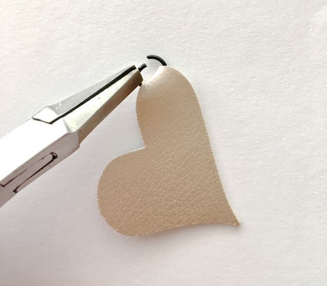 step 14 -With pliers, open a jump ring. Insert it into the fold of the double hearts and then the zipper pull. Close the jump ring.