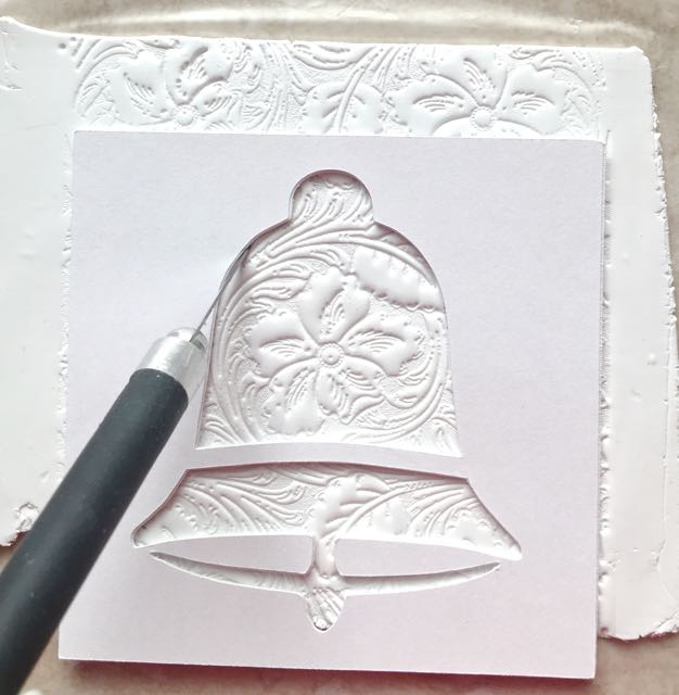 step 6 - Follow the outline of the bell impression with a craft knife.