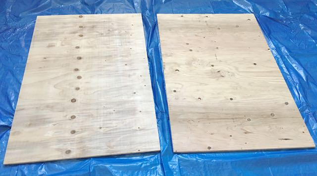 step 1 -  The Plywood  - Position both pieces of plywood on a protected surface. Slide them side by side with the edges touching (not shown in this photo).