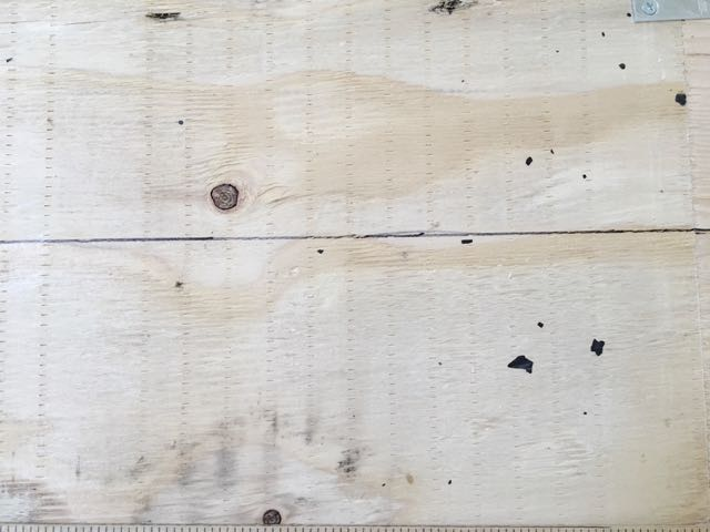 """step 5 - Draw a horizontal line across both pieces (totaling 62"""") of plywood 12"""" from the top of the wood. This line will help you to level the headboard when it is time to attach it to the wall."""