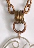 step 17 - Attach the bail to the pendant with one 6mm jump ring. Insert a copper chain into the bail.