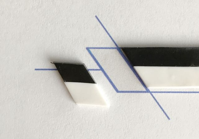 step 3 - Using a blade, slice the clay on the diagonal vertical line shown on the template.