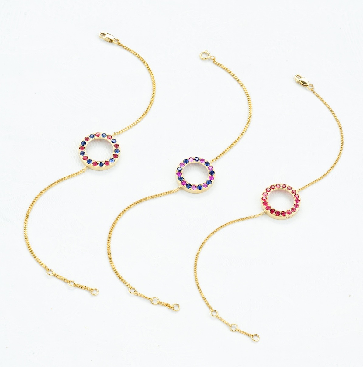 Gold Sapphire and Spinel Halo Bracelets