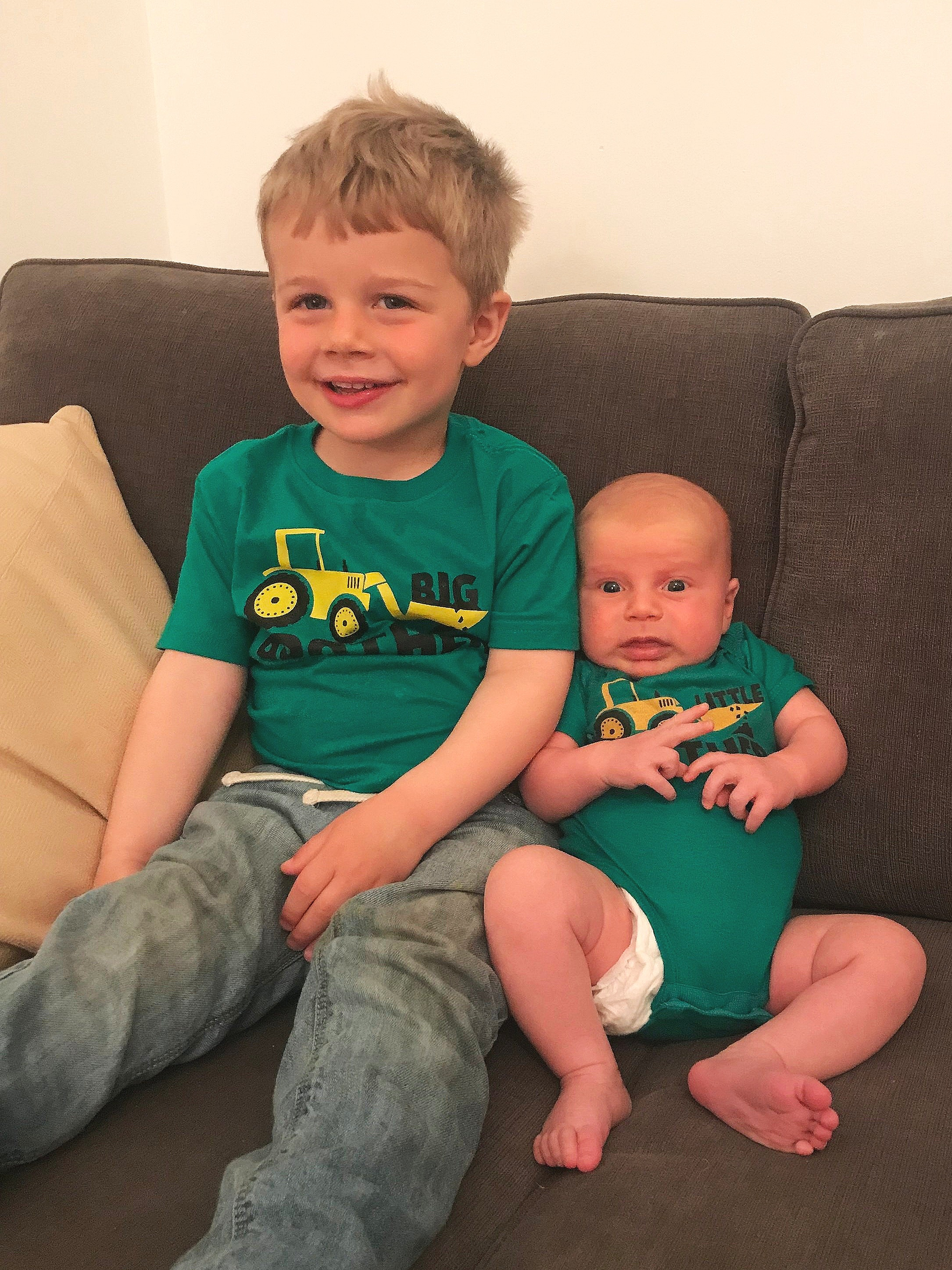 Baby Max is trying to smile and pretend he's not totally terrified of his big brother!