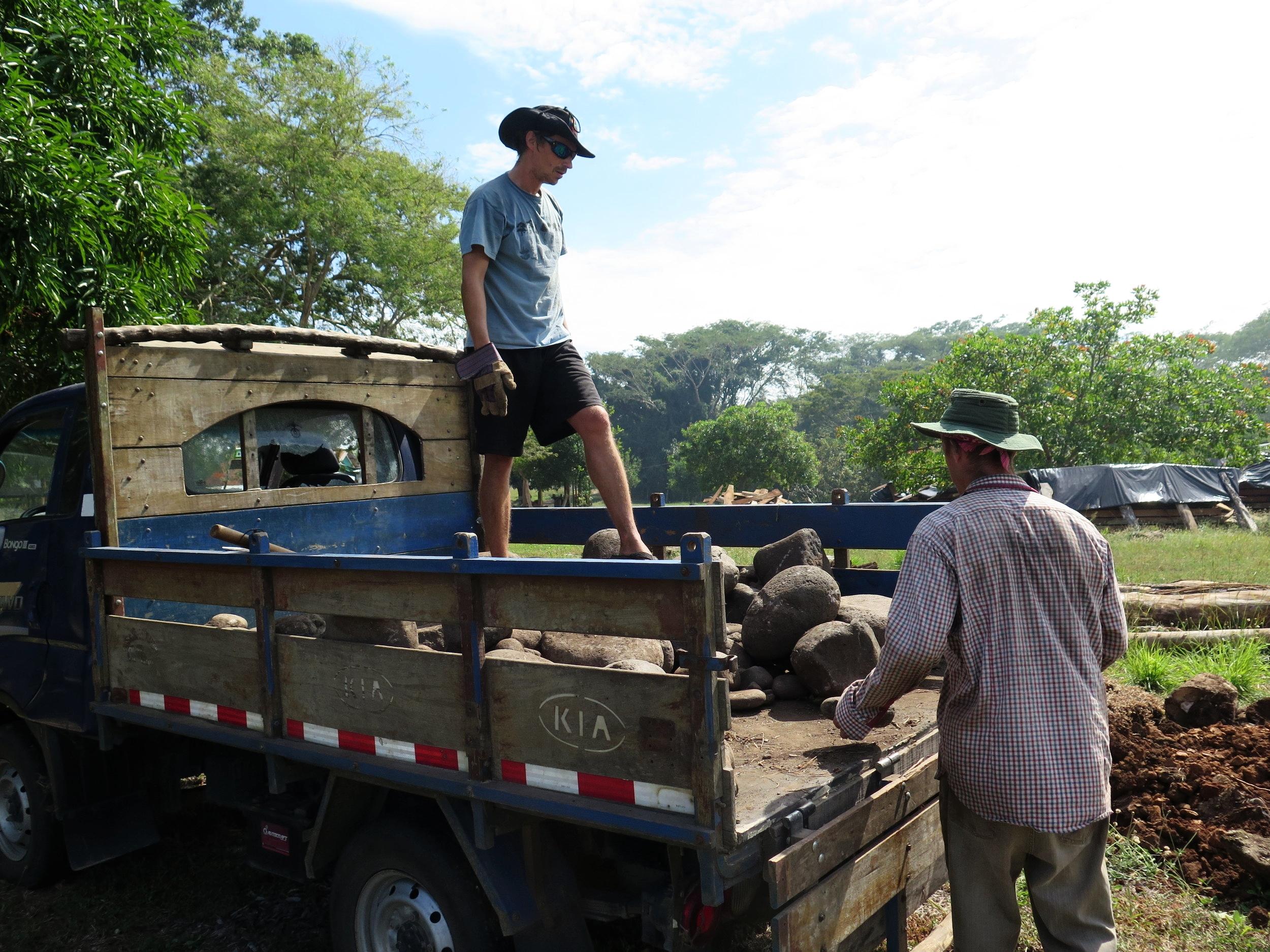Xavier & Lynx unloading river rocks for the keel foundation.