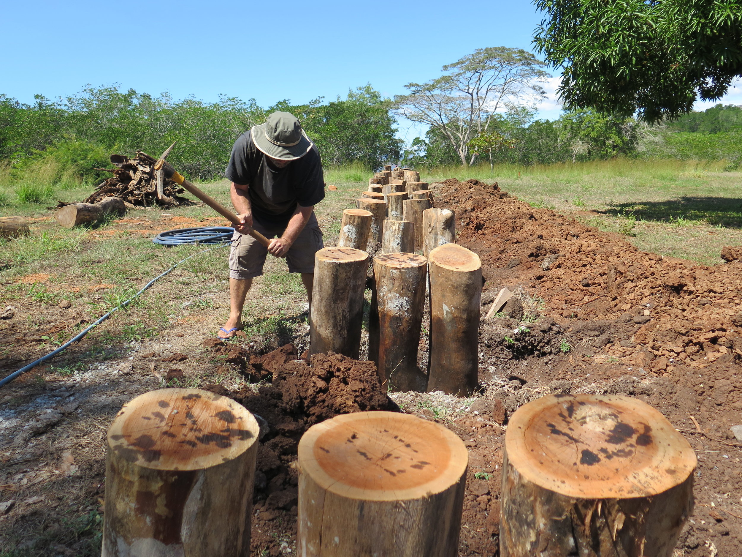 Location: Cocoroca, Punta Morales. Shipyard.  Richard works with the pick-ax to break apart the hard, dense clay around the foundation of where CEIBA's keel will be laid.