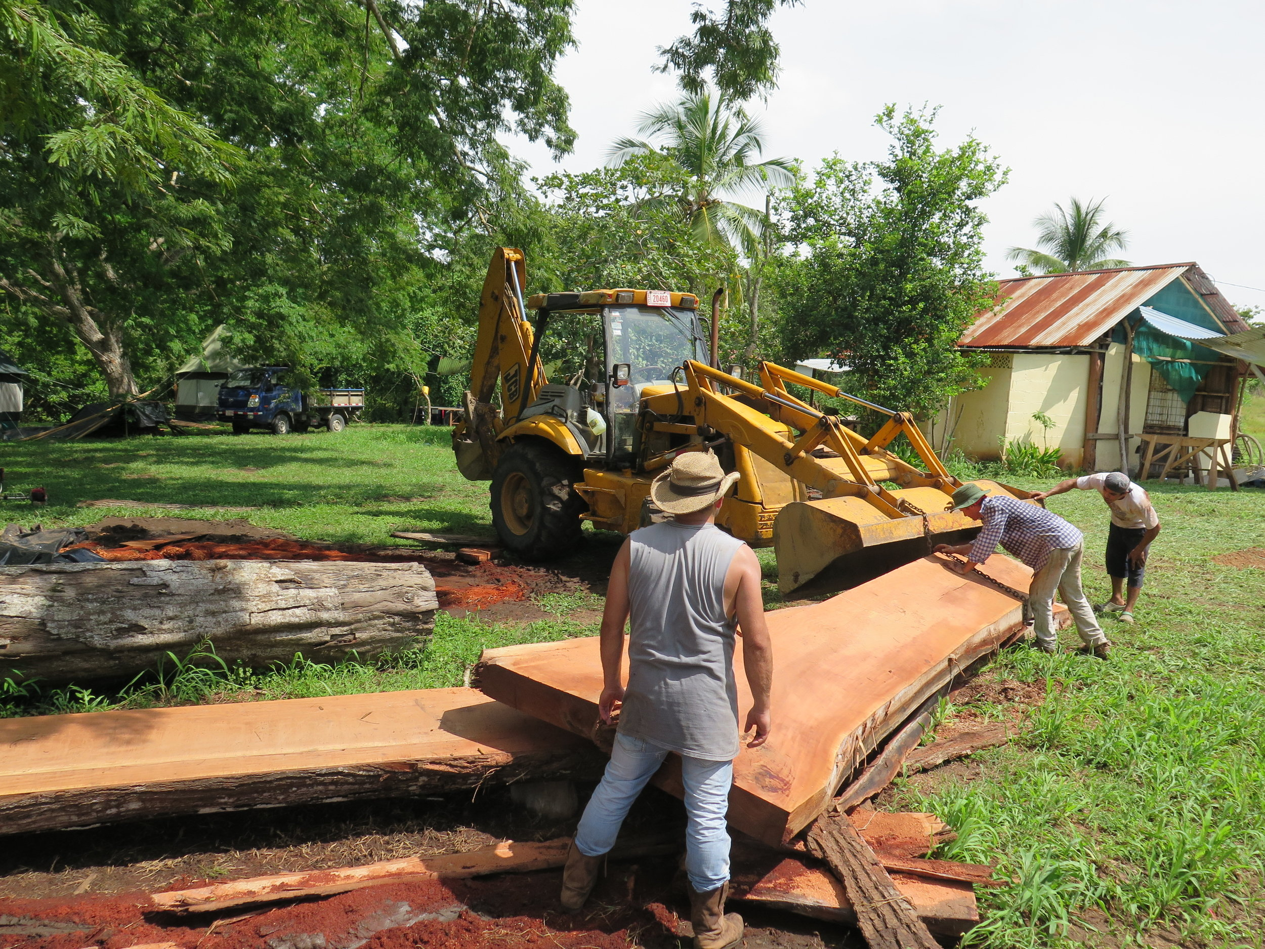 Location: Cocoroca, Punta Morales. Shipyard.  The neighborhood tractor at the yard, re-stacking the sawn timbers. These large pieces will soon become deckbeams of CEIBA. You can see the massive dimensions.