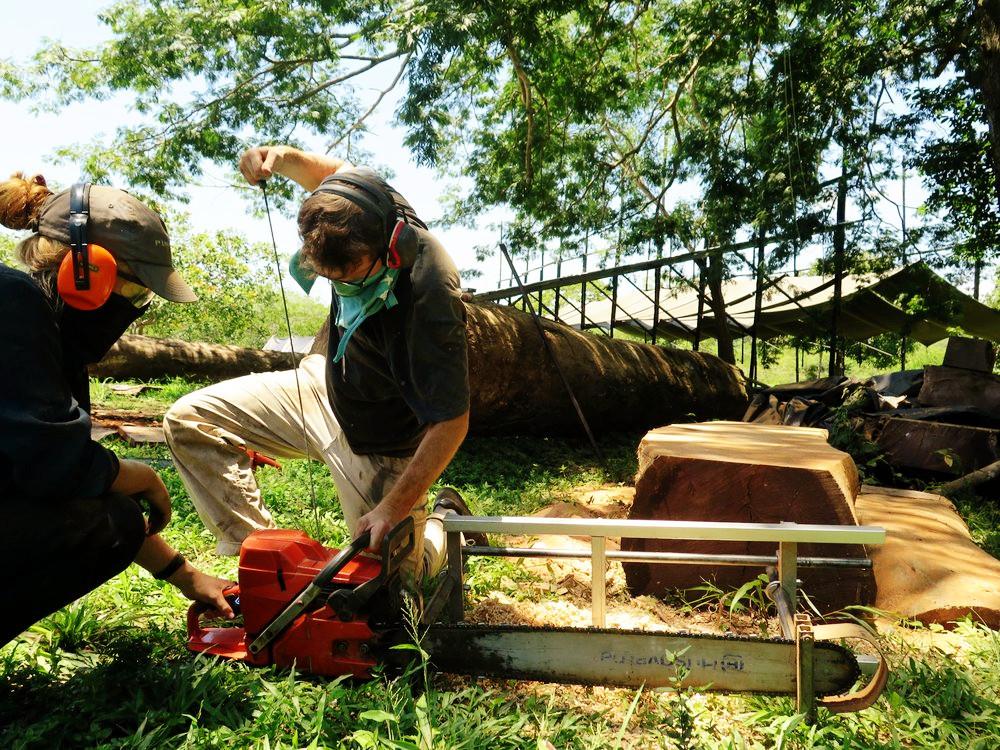 Shani and Charlie start the big saw.jpg