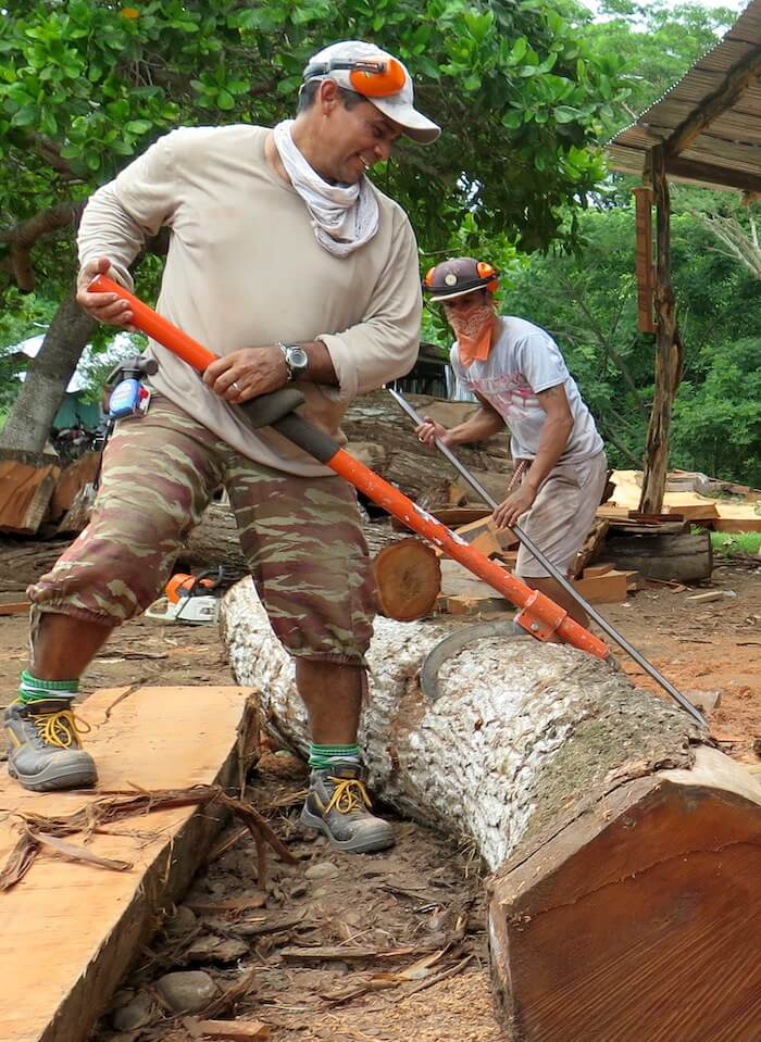 Misael (left) and Carlos moving heavy pieces of wood.  Picture taken by Danielle Doggett