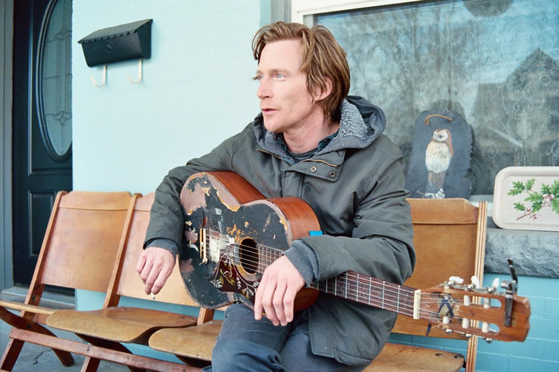 Joe Sampson has put some mileage on that guitar. (Glenn Ross)
