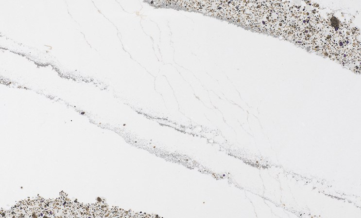 ANNICCA    A novel spin on classic marble, a neutral white background is infused with subtle gray veins, regal gold and purple sparkle that recall the majesty of court during the reign of Queen Anne.