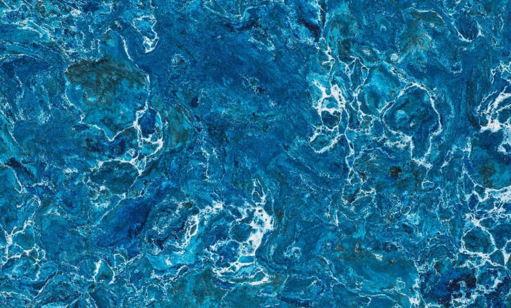 SKYE    Vibrant blues, greens, and grays dance with white veins that mimic the sea foam caps found off the rugged shores of Skye. Twisting and turning with intense, multi-dimensional patterns, this dynamic design presents an unprecedented reflection of nature in all its glory.