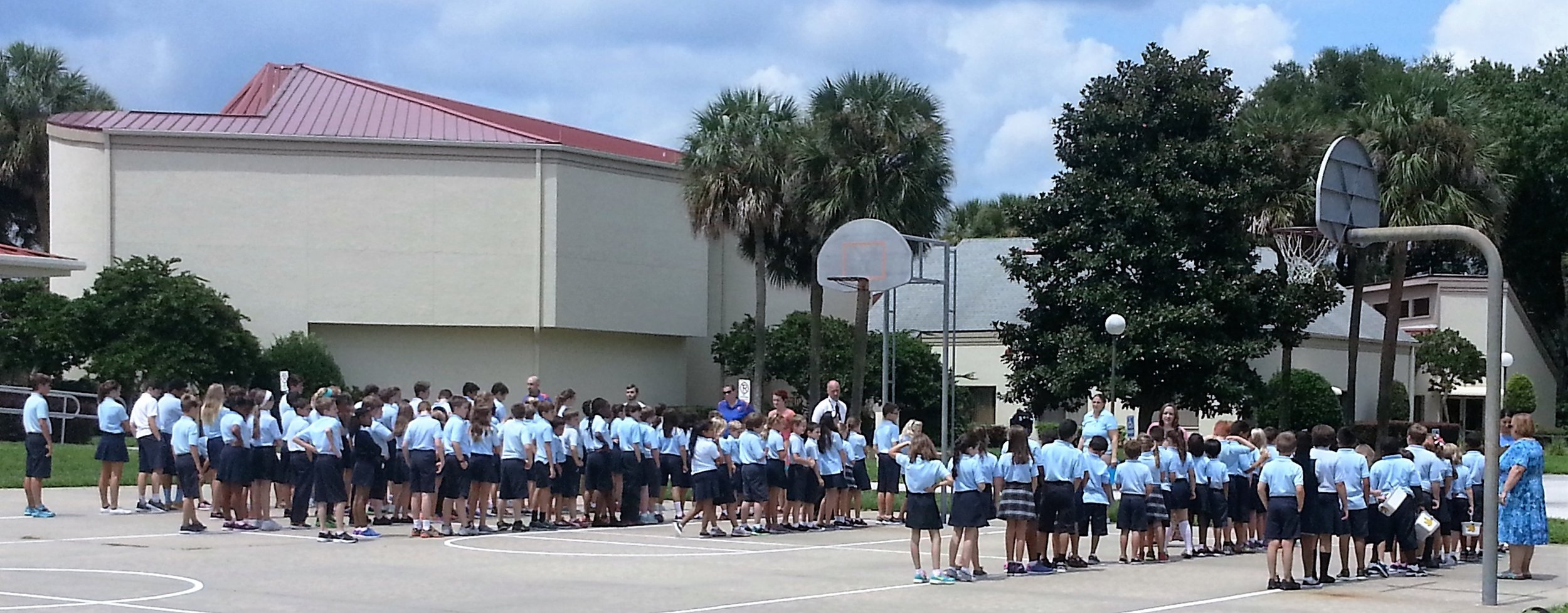 Students practice fire drills going to quickly and quietly to the outdoor basketball court.
