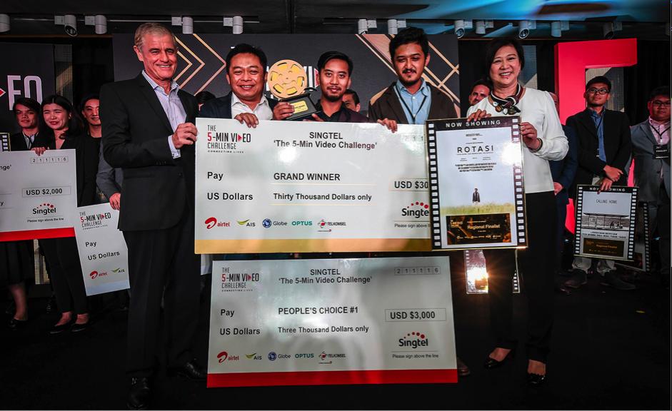 (From left): Mr Simon Israel, Chairman of Singtel Group; Pak Ririek Adriansyah, CEO of Telkomsel; Destian Rendra; Denny Pradana; and Ms Chua Sock Koong, GCEO of Singtel.
