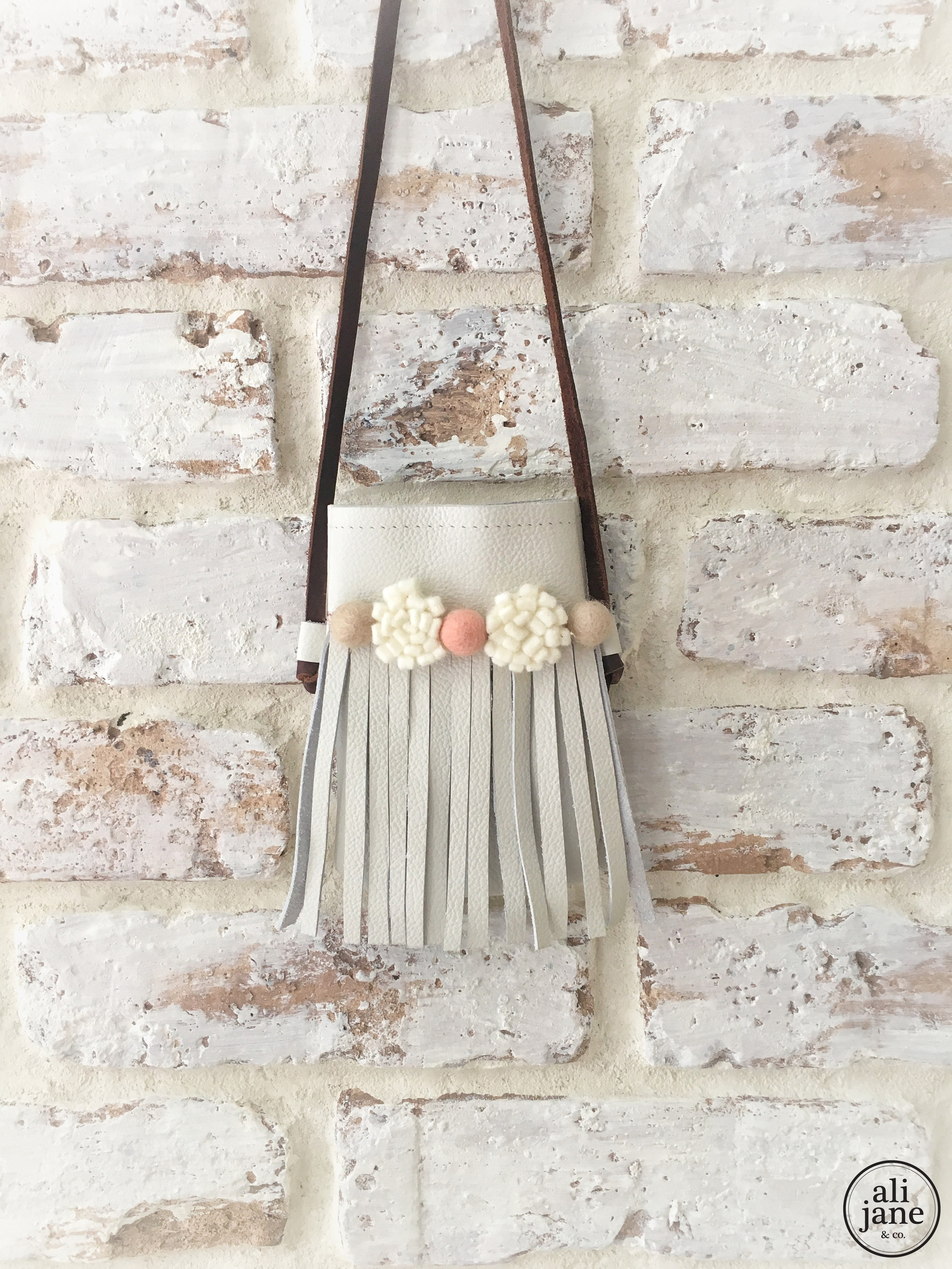 Girl's ivory leather boho fringe bag