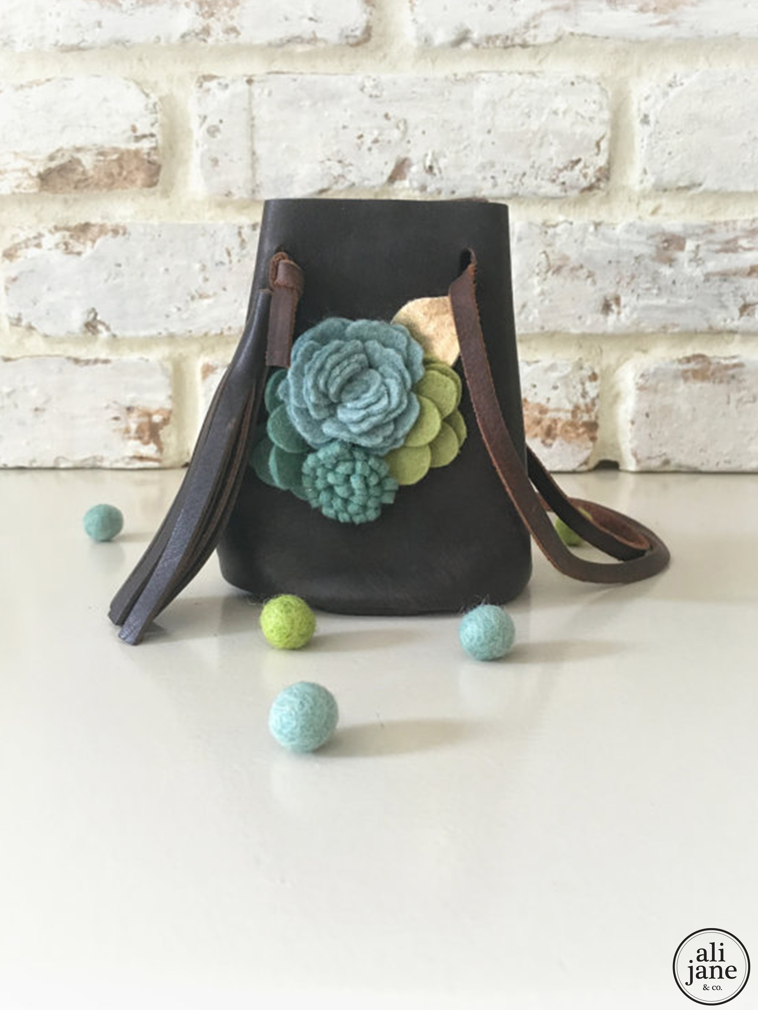 Mini dark brown vintage leather pouch with wool felt flowers