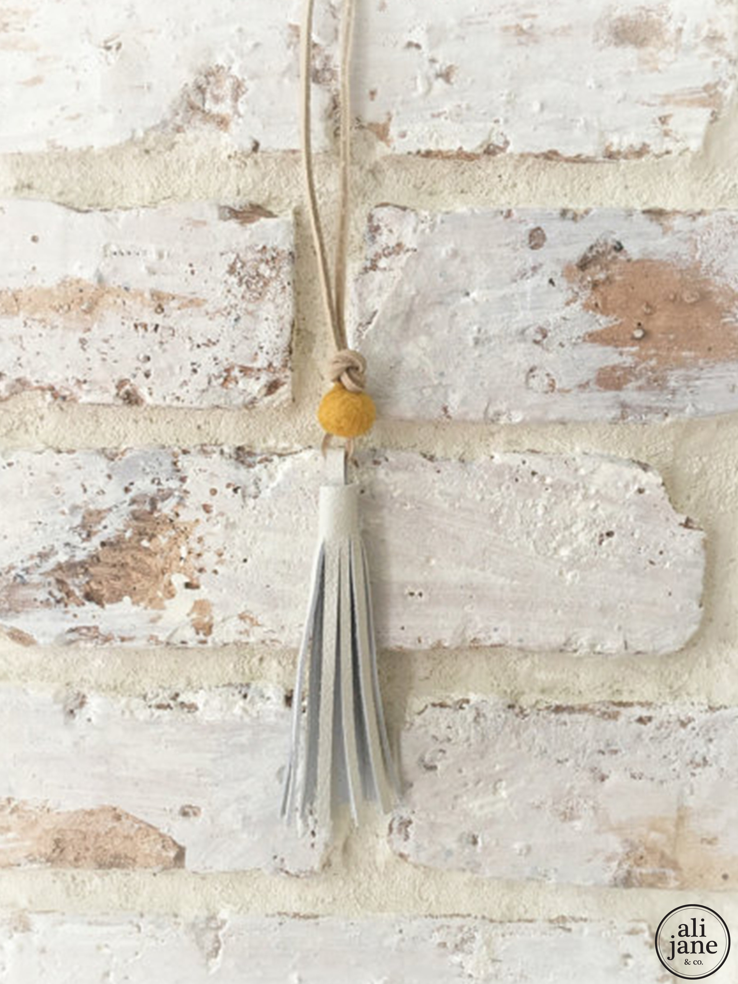 Ivory leather tassel necklace