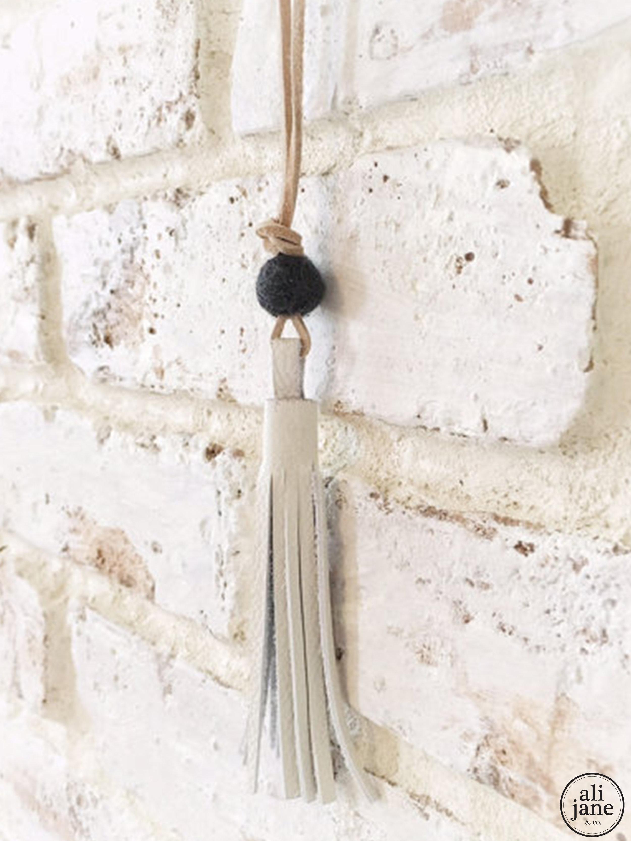 Little girls ivory tassel necklace with charcoal wool felt pom pom