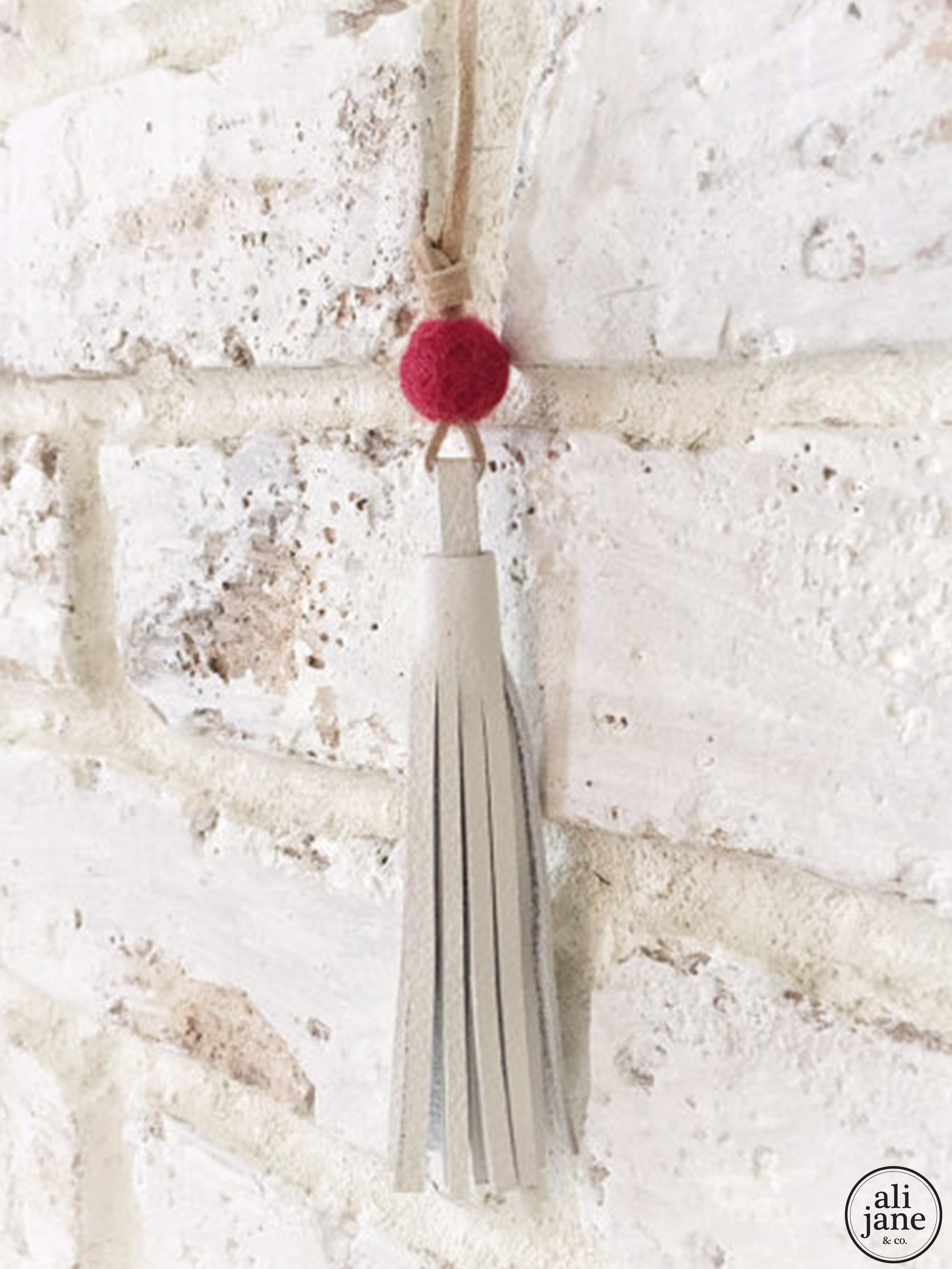 Little girls ivory tassel necklace with red wool felt pom pom