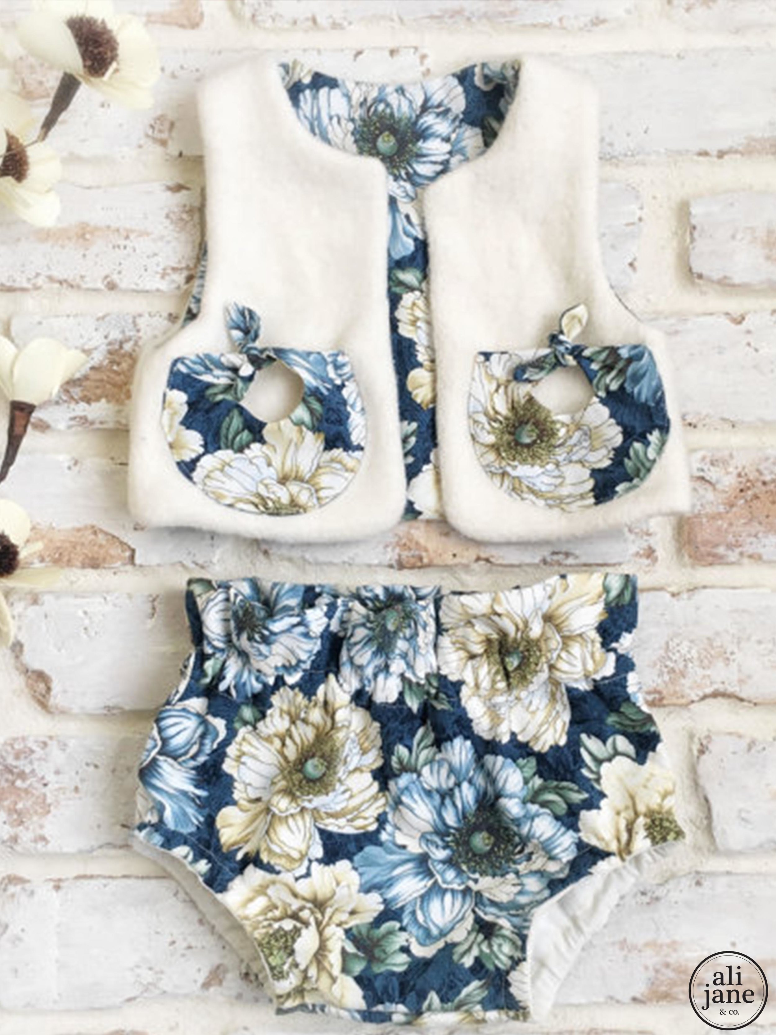 Baby girl's reversible organic sherpa vest