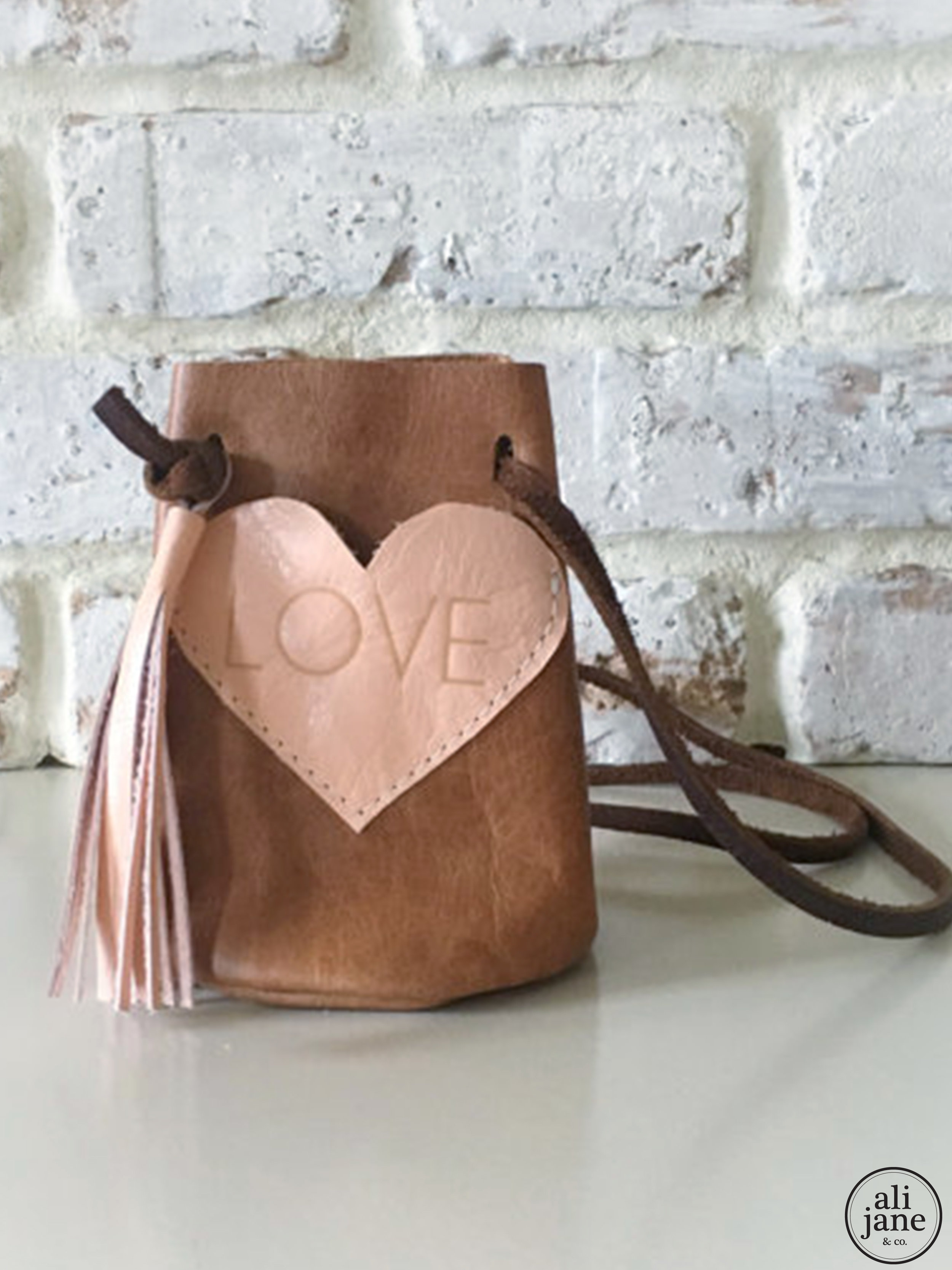 Girl's tan leather LOVE purse