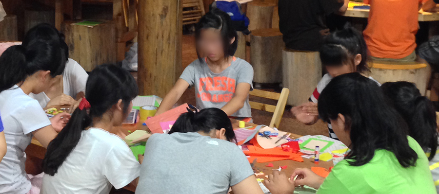 Ha-neul working on crafts at our annual children's retreat.