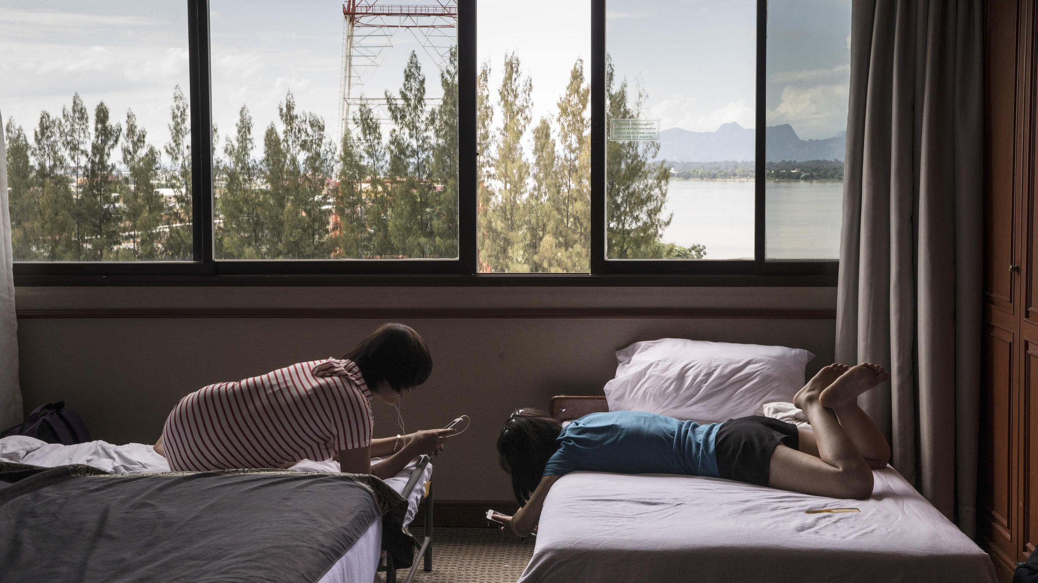North Korean defectors rest in a hotel room in Thailand. They will be sent to Seoul, where they will become South Korean citizens.  (Paula Bronstein / For The Washington Post)