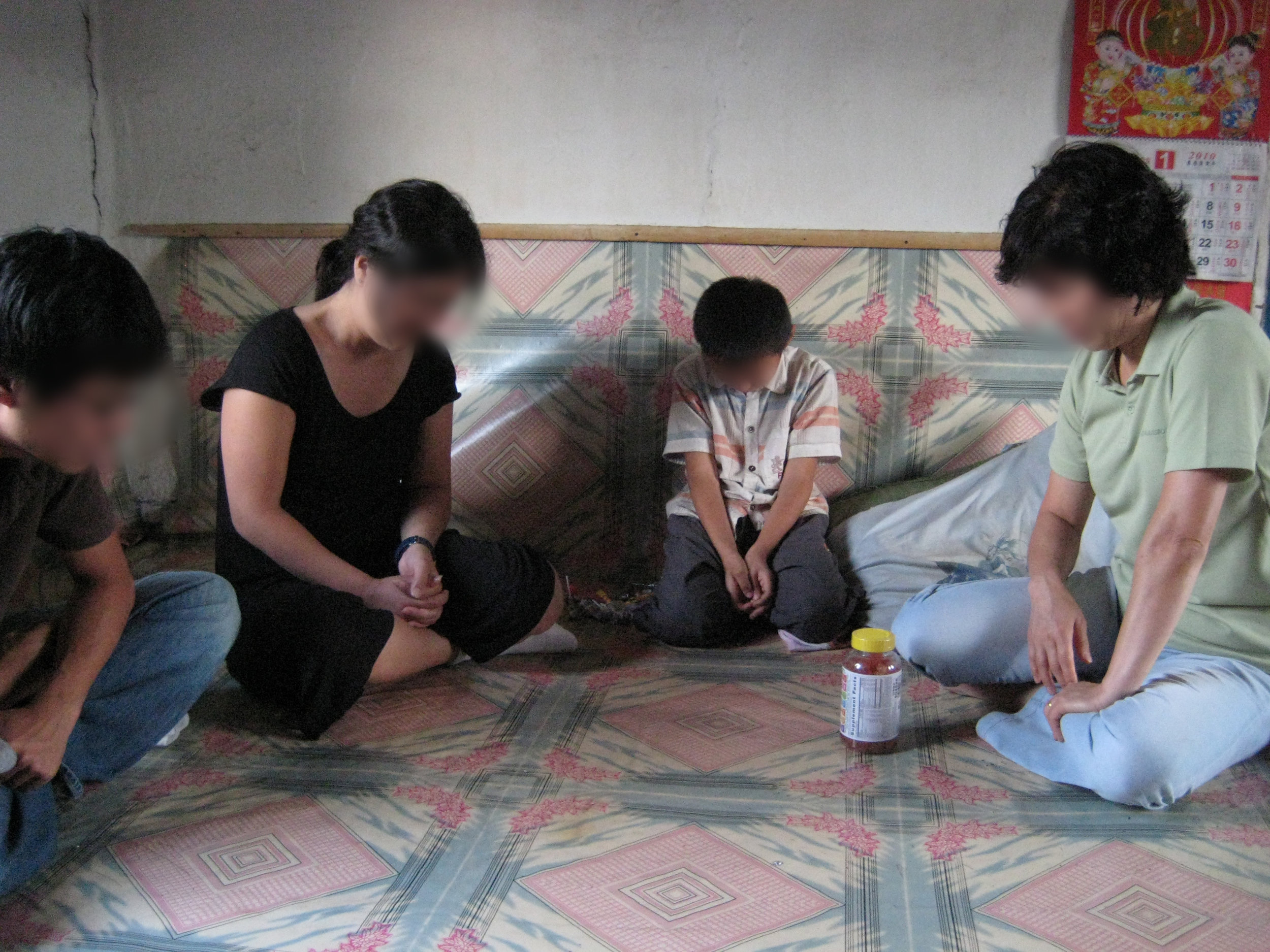 Praying for KyungTae and his family in 2010.