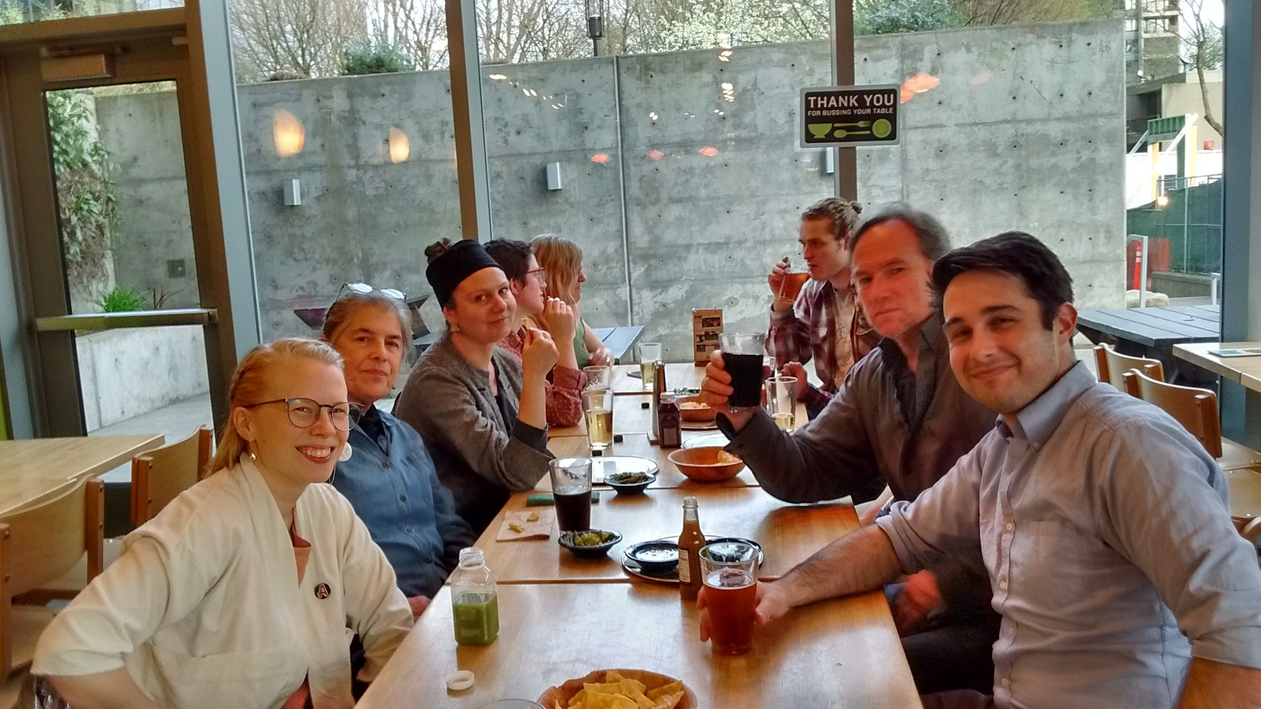 Your team (or most of them, if you look closely you can see Barry's fist behind Bill's beer) decompressing with drinks, guac and some GEU solidarity