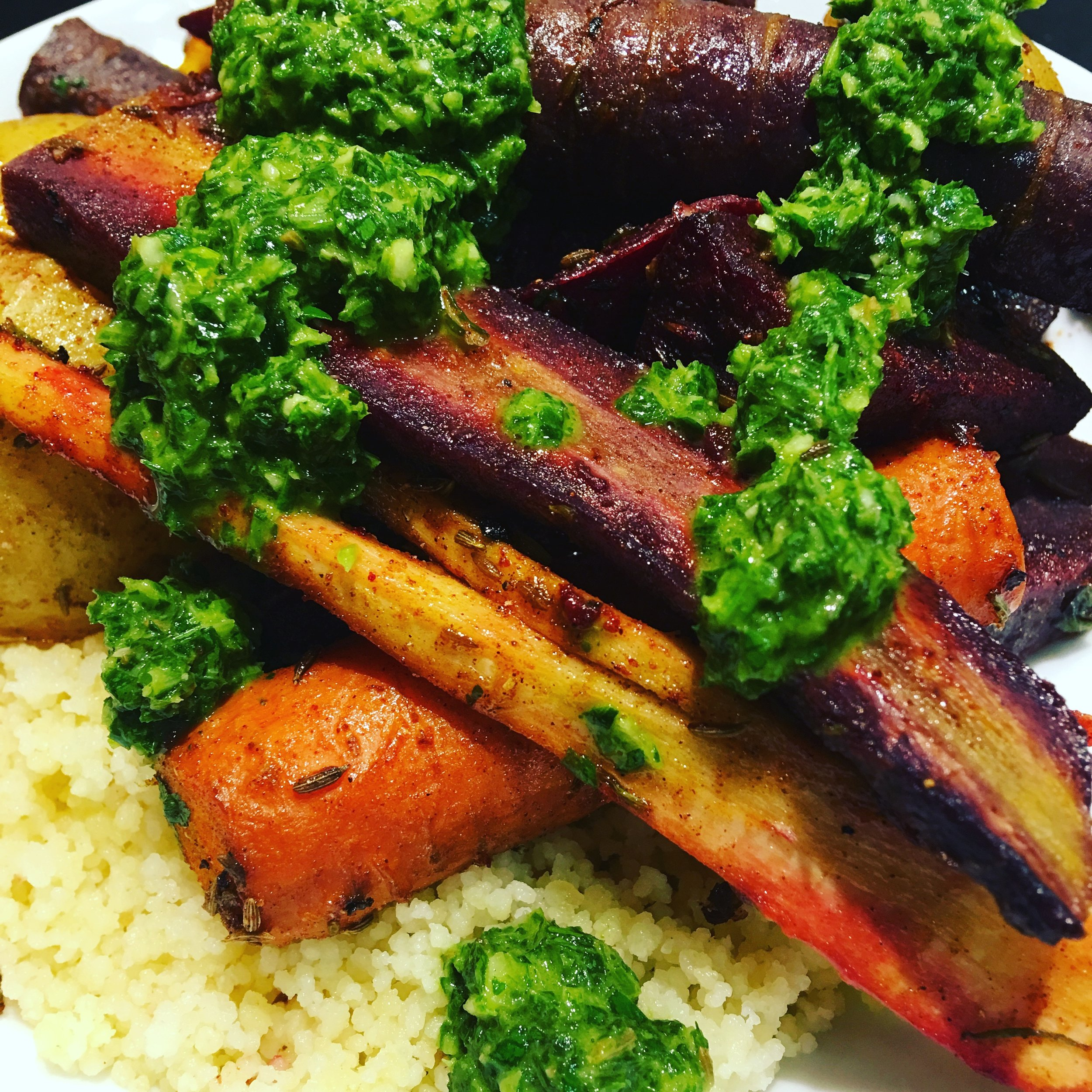 Spice-Roasted Vegetables With Chermoula  from the Sprouted Kitchen; I didn't have chickpeas, but it was still lovely, and I served it over buttered couscous