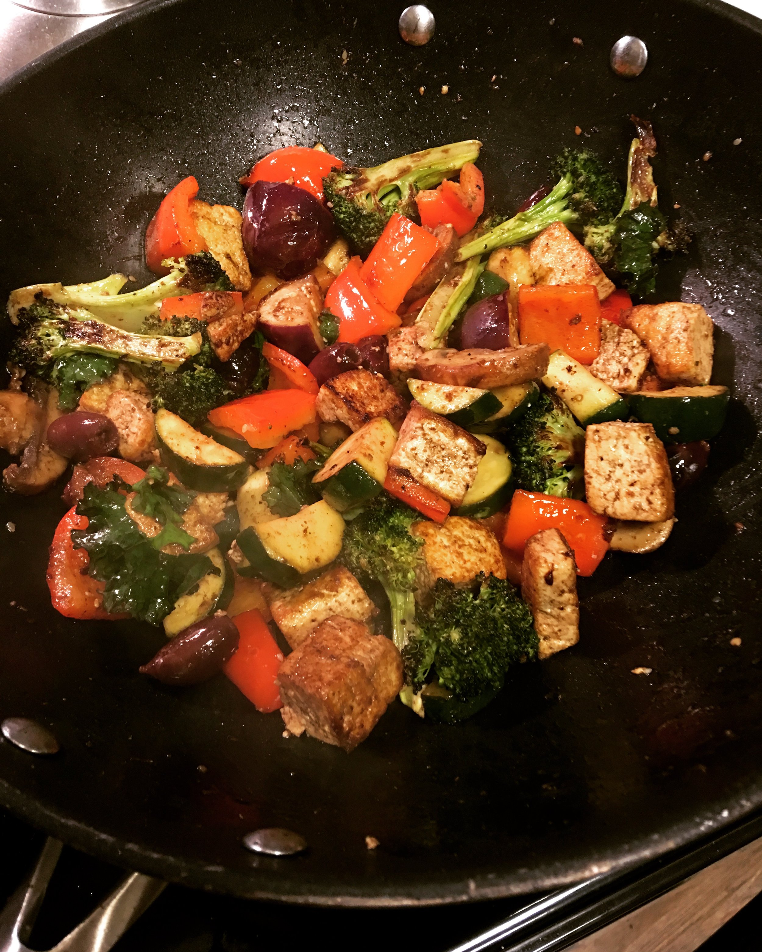 "Greek Skillet With Tofu, Kale and Fig-Balsamic Vinaigrette   This was a ""use up everything in the fridge"" recipe; first I pan-fried the tofu, then tossed in zucchini, bell pepper, kalamata olives, some leftover roasted broccoli, baby Thai eggplants, mushrooms and kale. I also tossed in some pre-made fig-balsamic vinaigrette and finished it with crumbled feta."