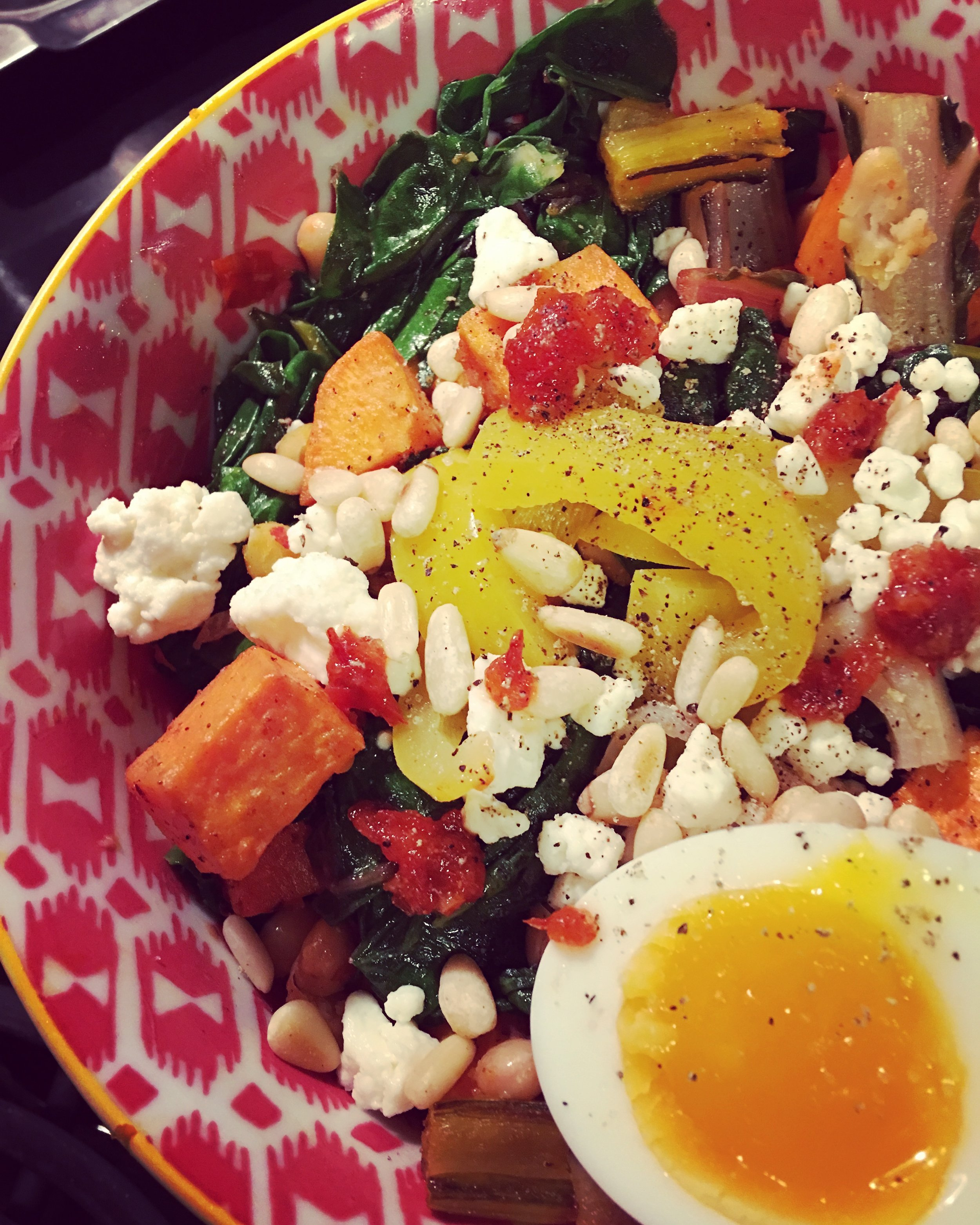 Berbere Veggies: Variation #2   With sweet potatoes, 7-minute eggs, stir-fried Swiss chard and chard stems, harissa, pine nuts, feta, and pickled bell peppers.