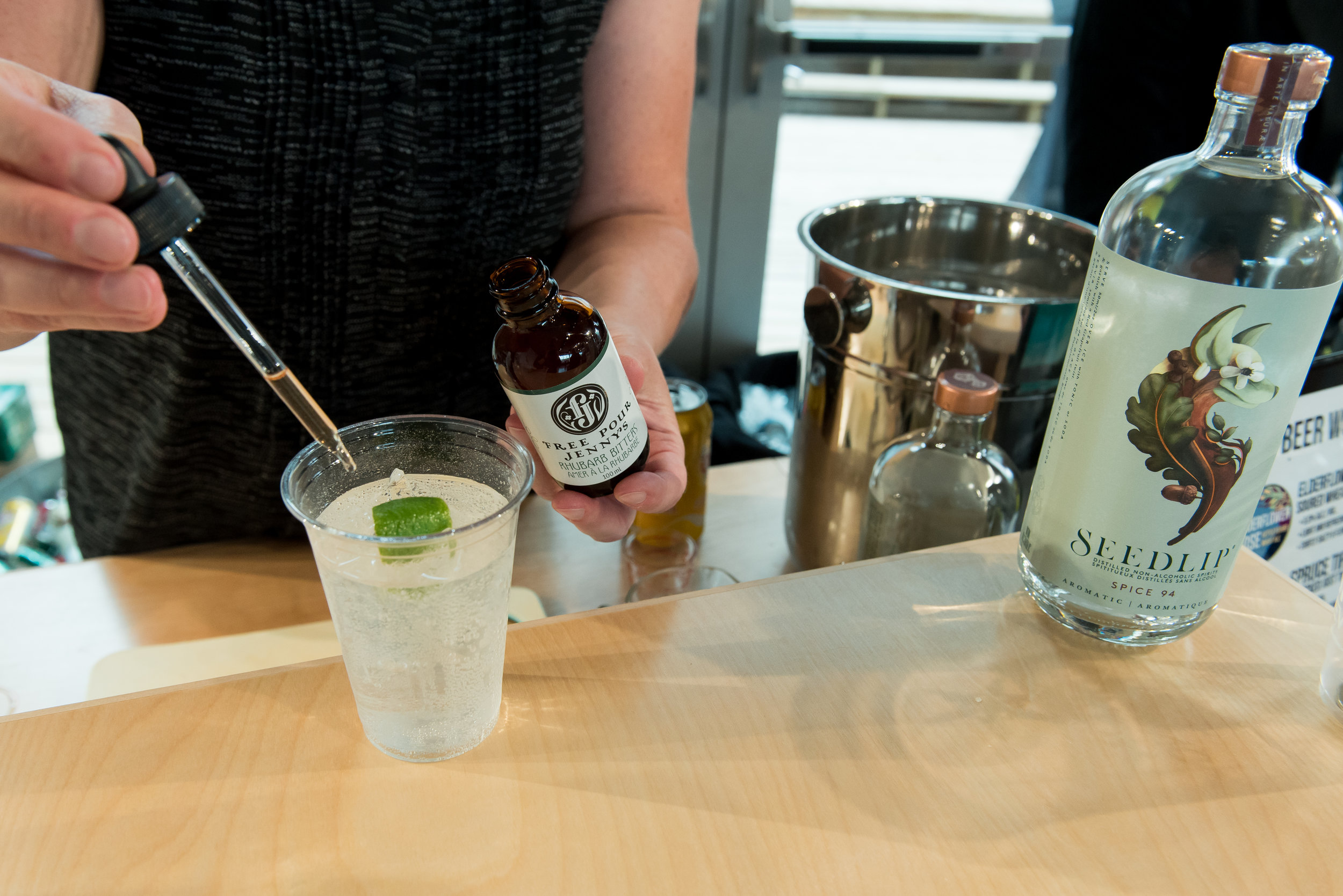 Making a mocktail with Seedlip Spice, tonic, and FPJ Rhubarb Bitters at the Yukon Culinary Festival, August 2019