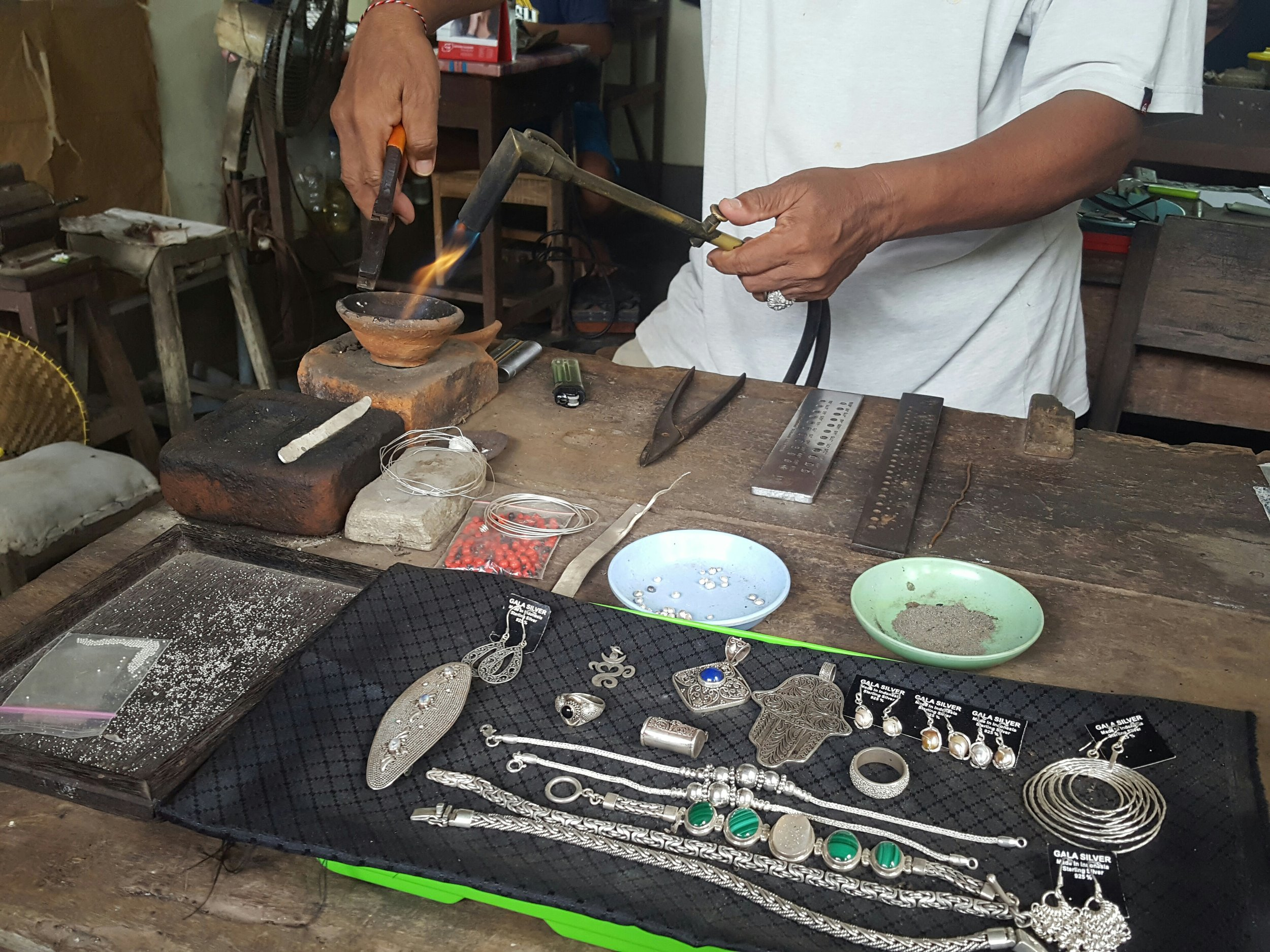 A silversmith working his magic