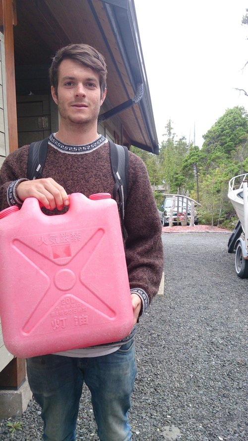 Daniel holds a refillable Japanese kerosene container: kerosene is widely used in Japan in the winter to heat homes.