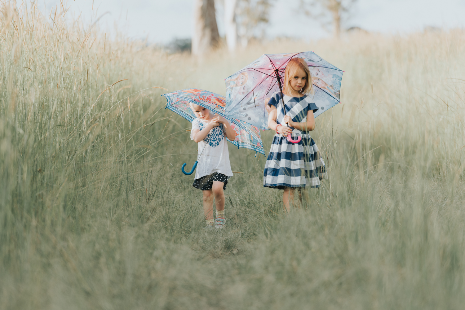 Cute little girls walking with umbrellas | Sirromet Winery | Lightsmith Images