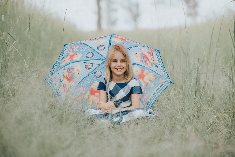 Pretty little girl under umbrella | Sirromet Winery | Lightsmith Images