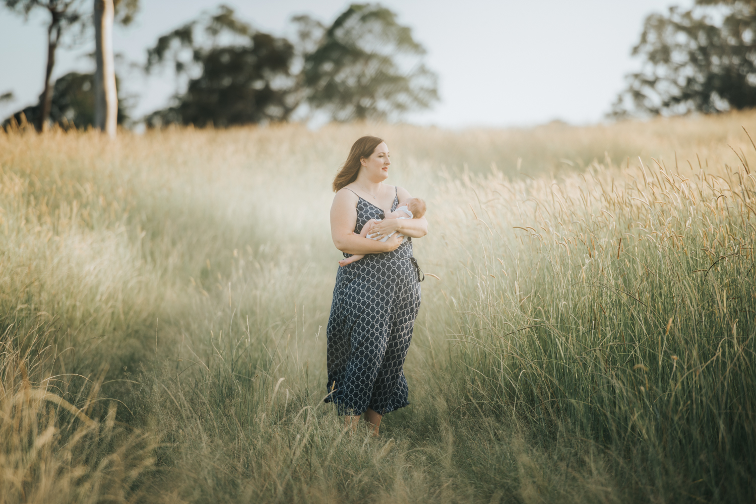 Beautiful mother with baby in a field | Sirromet Winery | Lightsmith Images