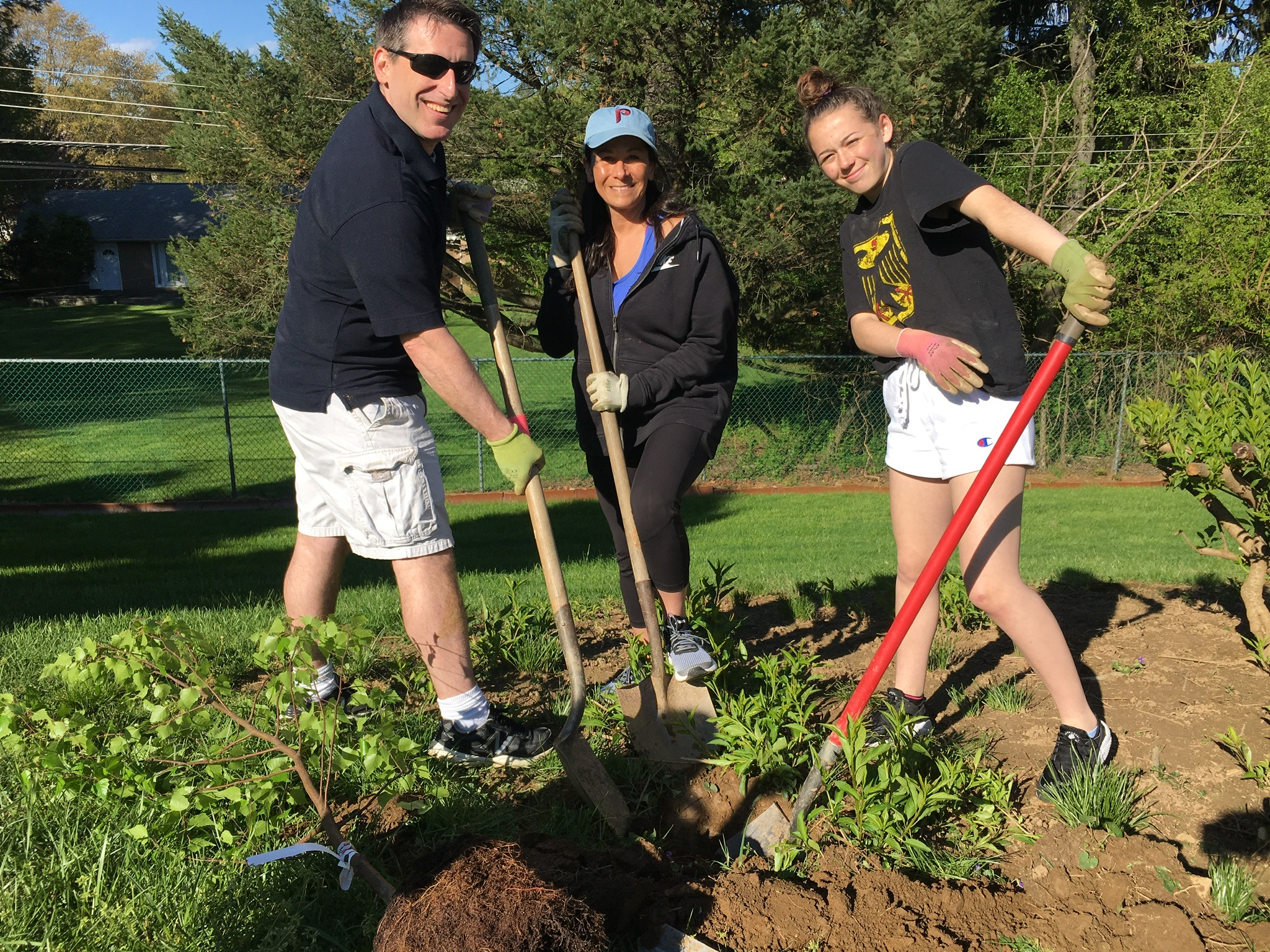 Commissioner Mike McKeon and his family help plant trees at Penn Valley Elementary School.