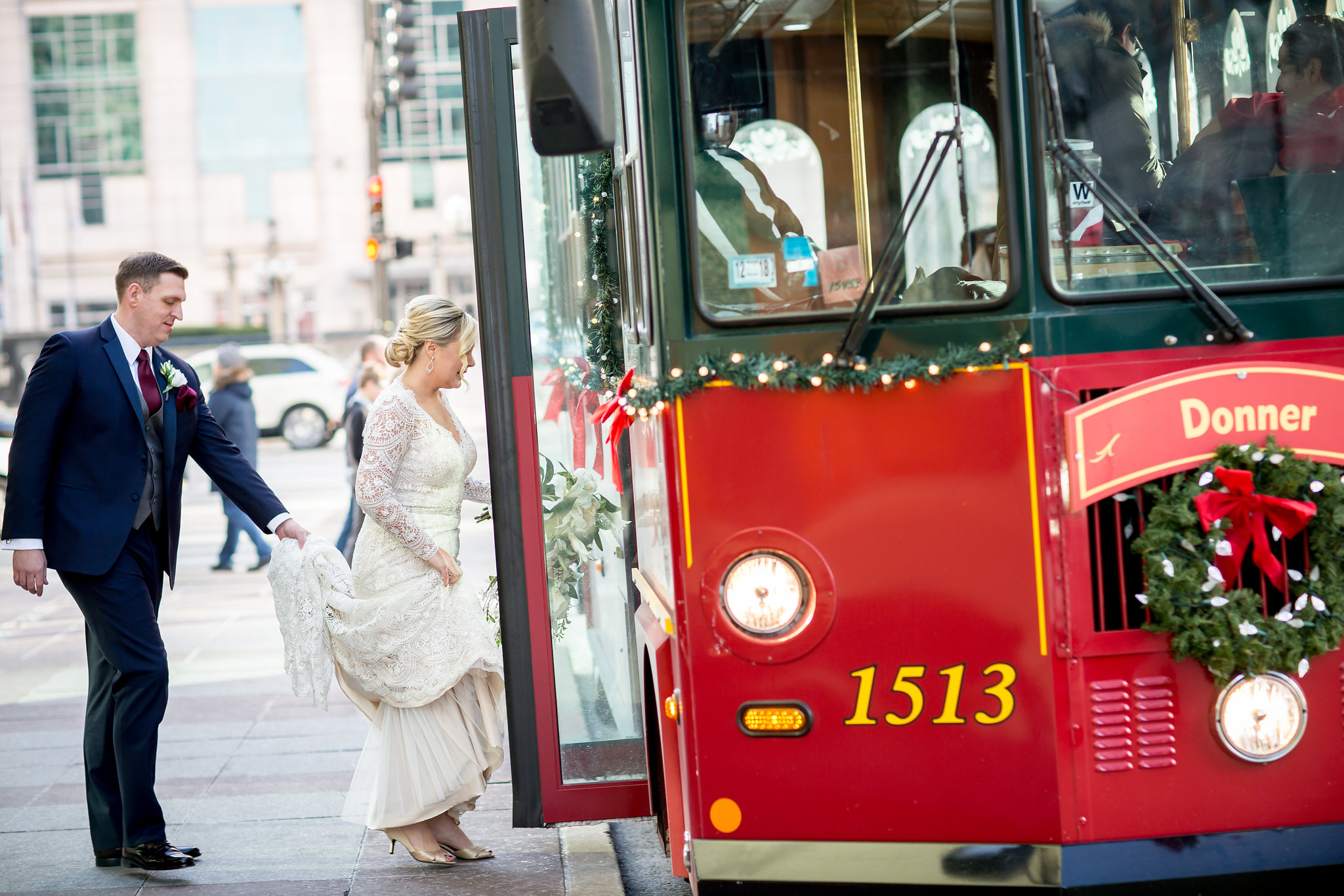 You can't have a holiday season wedding and ride in anything BUT a holiday themed trolley, right?!