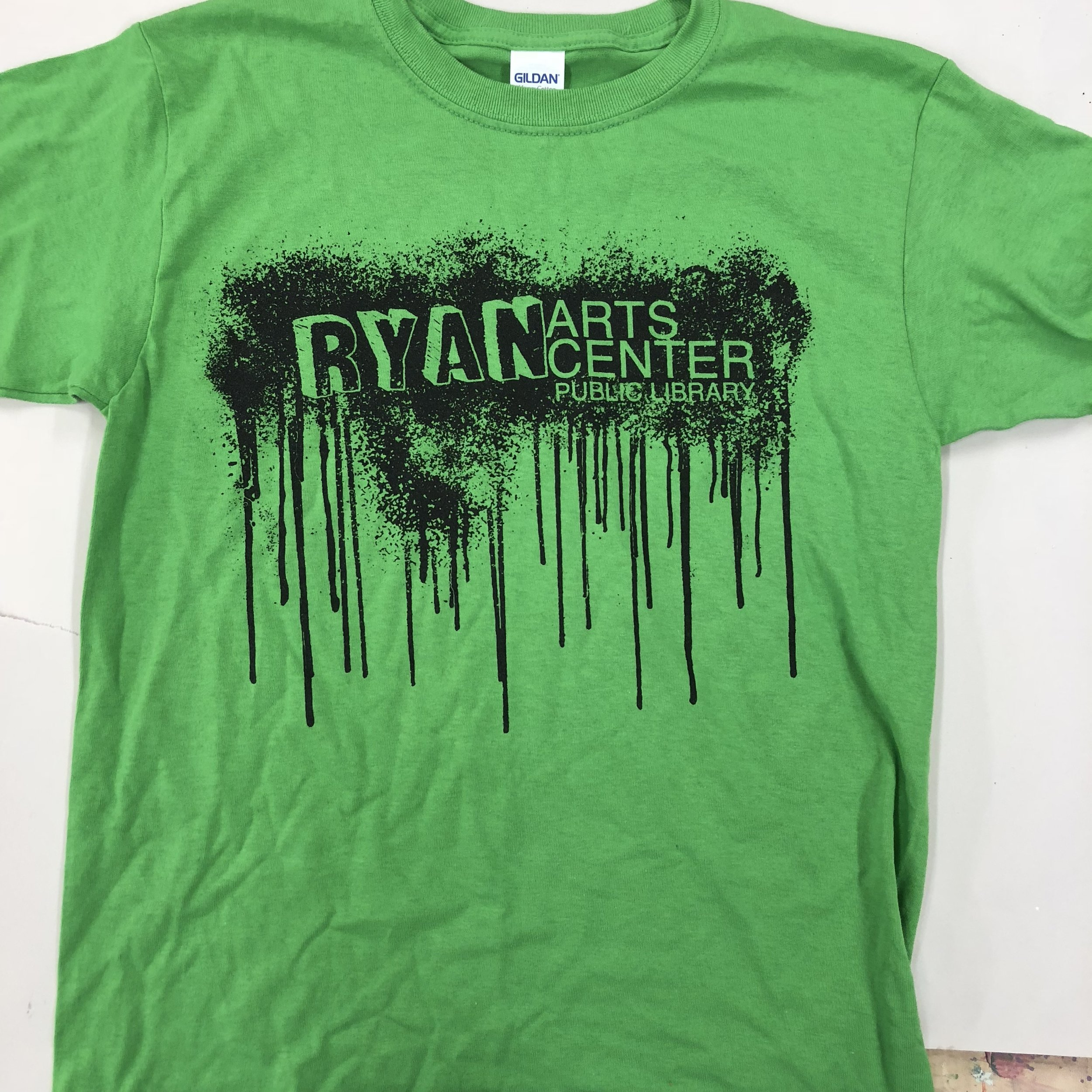 RYAN ARTS DRIP   Black print on green shirt  $10