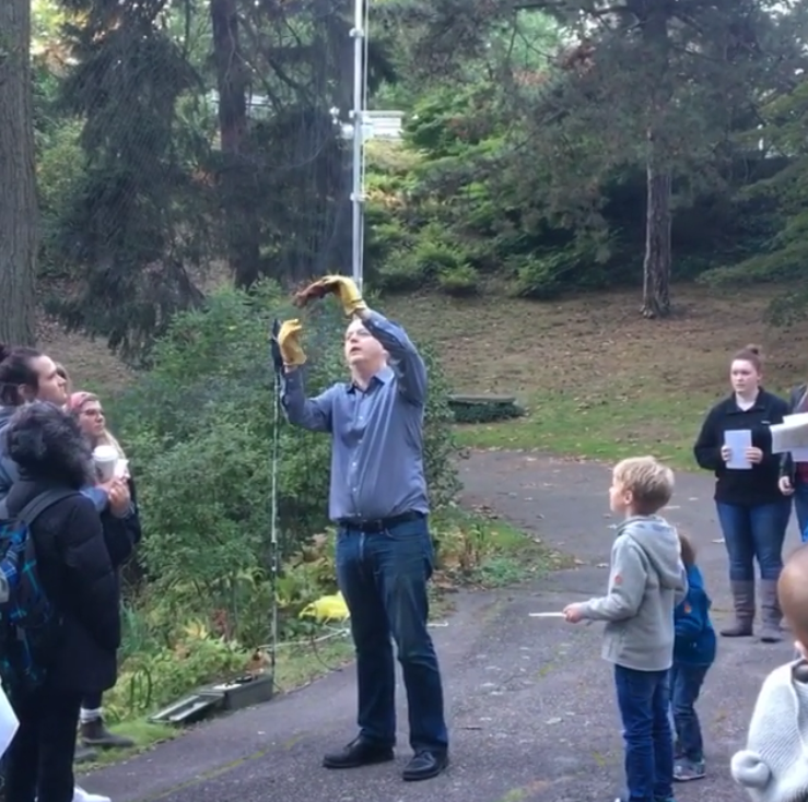 Lesley Professor, Christopher Richardson demonstrates his techniques for catching and studying bats in the cemetery.
