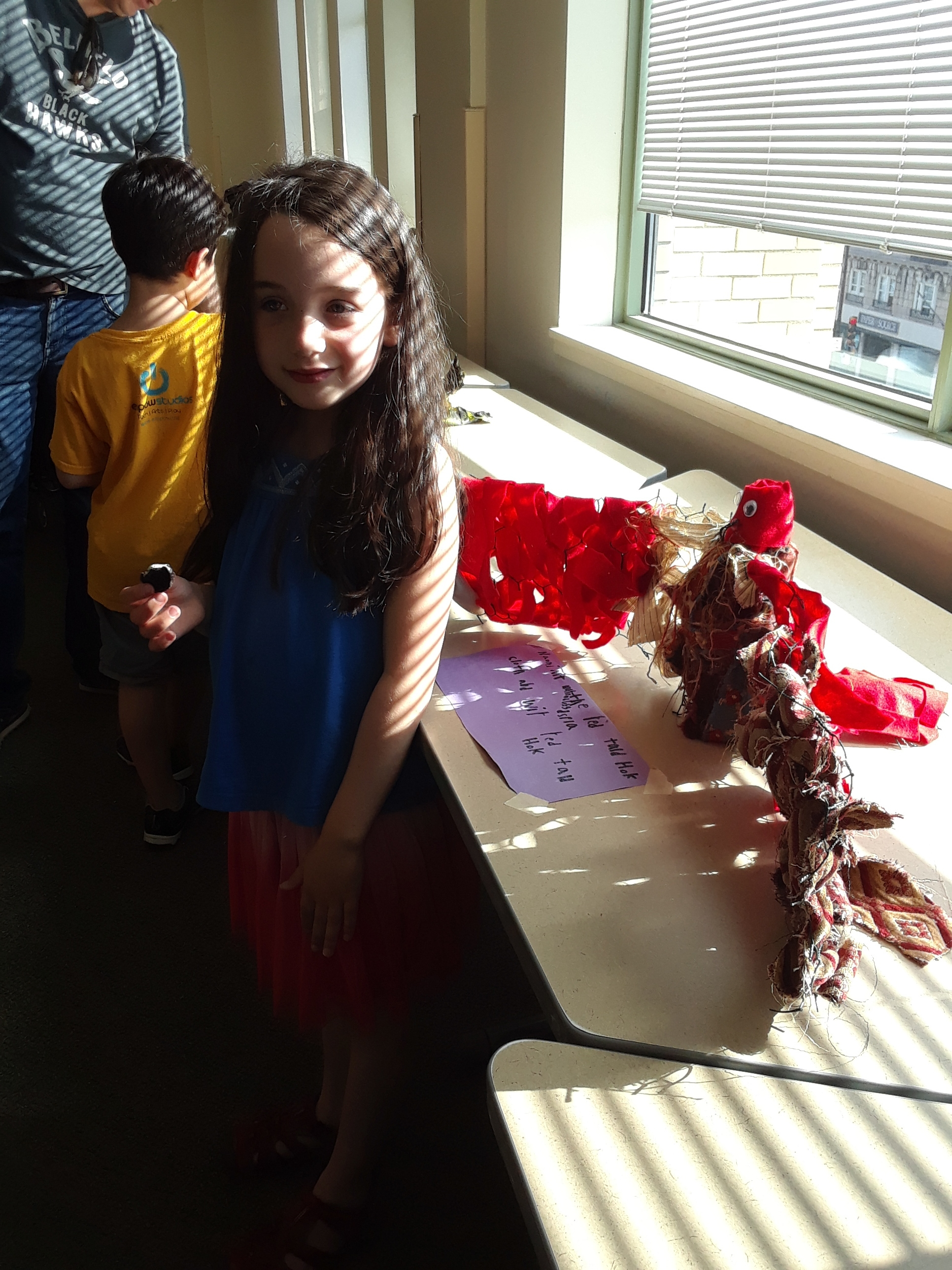 Student and her Red Tail Hawk sculpture
