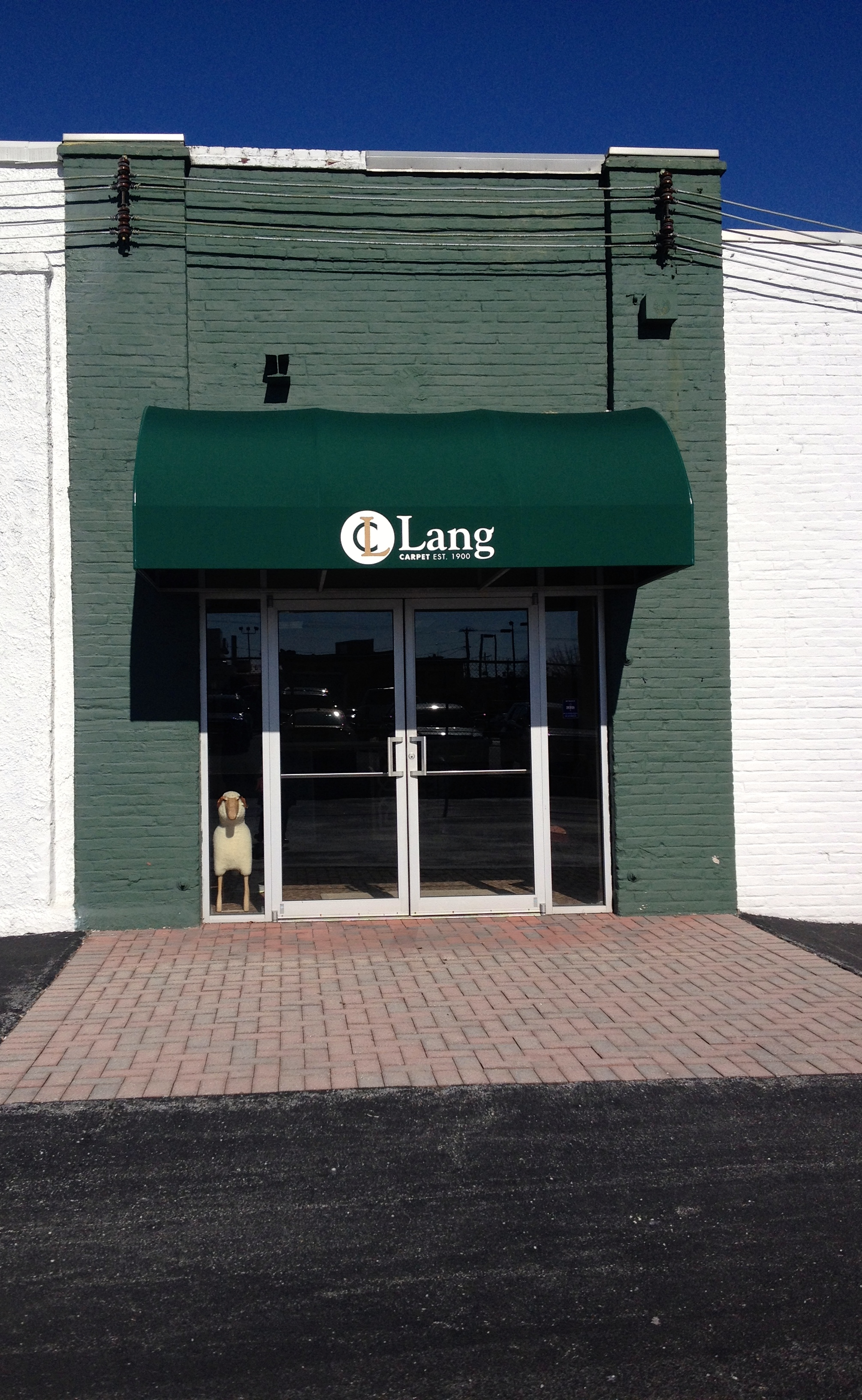 This picture is of our Lang Carpet front door. Our honorary sheep mascot is in the window.