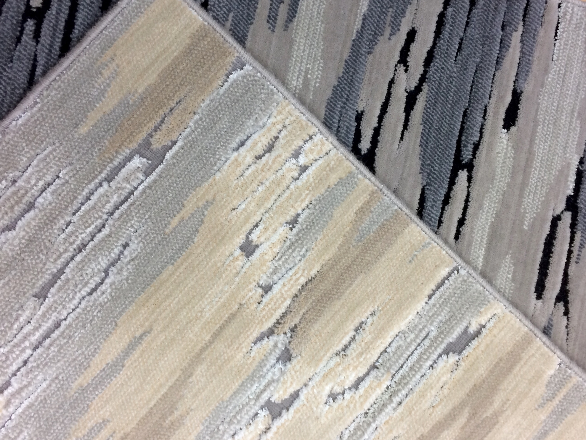 Riptide high-low textured carpet sample with shine accents