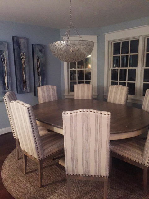 Custom-made round sisal rug under a dining table