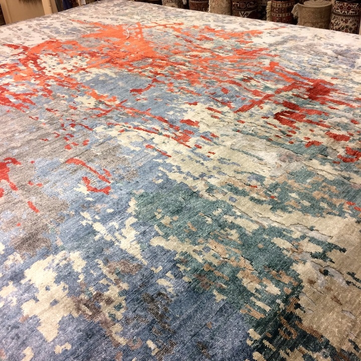 Contemporary hand-knotted oriental rug in blue and red.